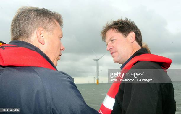 Liberal Democrat leader Nick Clegg talks to Alan Thompson Head of Renewables Centrica Energy underneath one of the wind turbines at the Inner Dowsing...