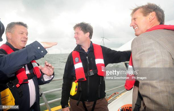 Liberal Democrat leader Nick Clegg talks to Alan Thompson Head of Renewables Centrica Energy and Phil Bentley Managing Director of British Gas during...