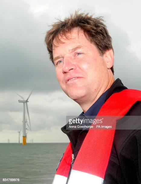 Liberal Democrat leader Nick Clegg underneath one of the wind turbines at the Inner Dowsing offshore wind farm in the North Sea