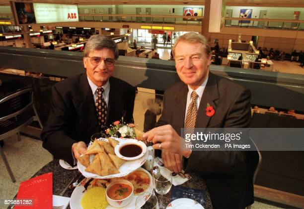 Liberal Democrat leader Paddy Asdown tucks into a plate of tasty samozas handed to him by Mr G K Noon the owner of a new Indian restaurant which...