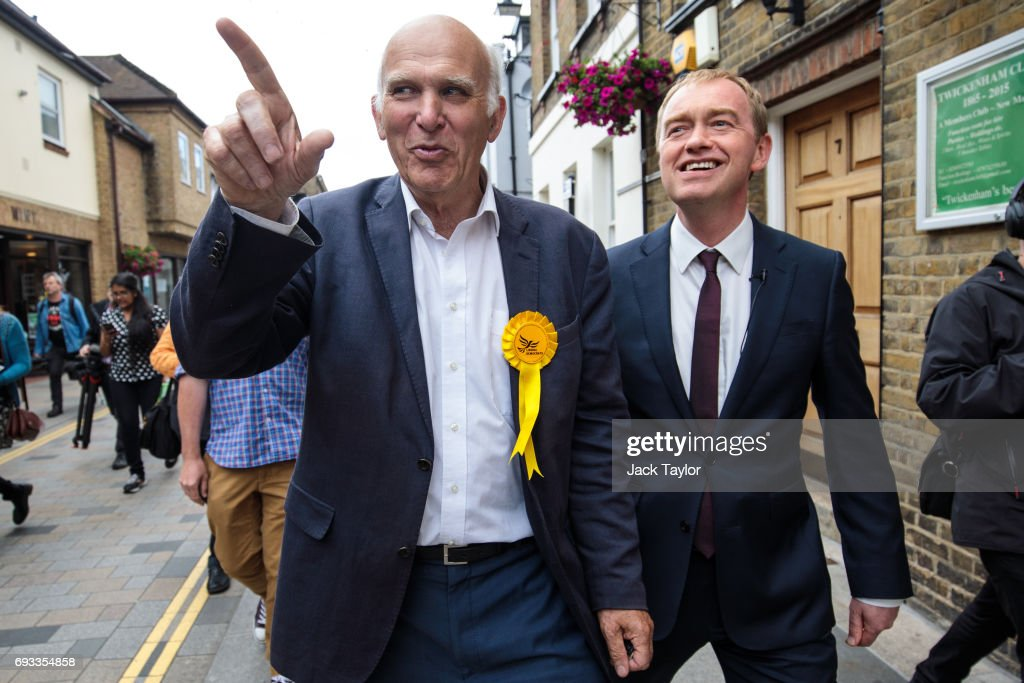 Liberal Democrat Leader Tim Farron (R) and former Secretary of State for Business, Innovation and Skills Vince Cable (L) campaign in Twickenham on June 7, 2017 in Twickenham, England. Mr Cable is campaigning to retake his former seat after it was won by Conservative Tania Mathias in the 2015 general election. Britain goes to the polls tomorrow June 8 in a general election.