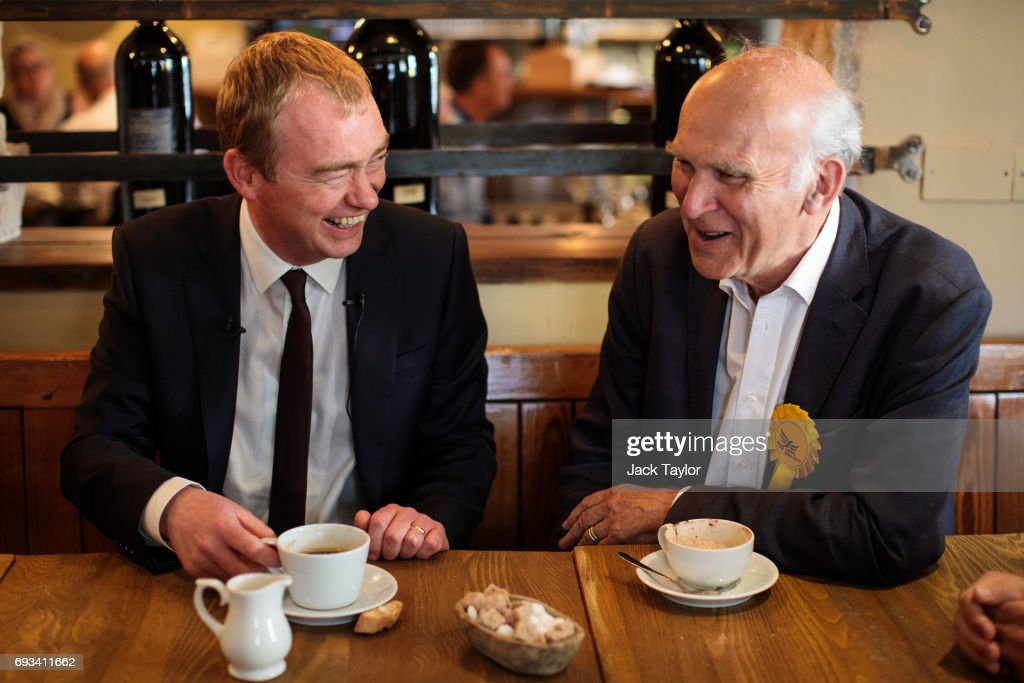 Liberal Democrat Leader Tim Farron (L) and former Secretary of State for Business, Innovation and Skills Vince Cable (R) sit in a restaurant as they campaign in Twickenham on June 7, 2017 in Twickenham, England. Mr Cable is campaigning to retake his former seat after it was won by Conservative Tania Mathias in the 2015 general election. Britain goes to the polls tomorrow June 8 in a general election.