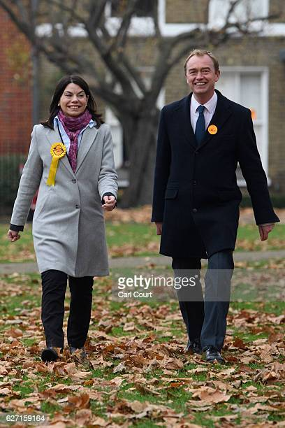 Liberal Democrat leader Tim Farron and Sarah Olney walk to speak with waiting media following Olney's victory in the Richmond Park byelection on...