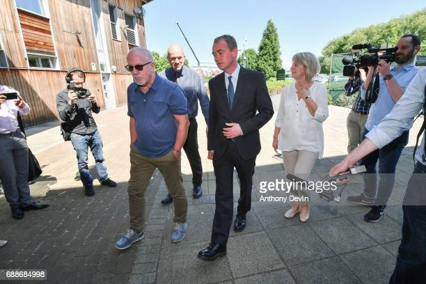 Liberal Democrat leader Tim Farron arrives with Colin Parry and Wendy Parry the parents of Tim Parry during a visit to the Tim Parry Jonathan Bell...