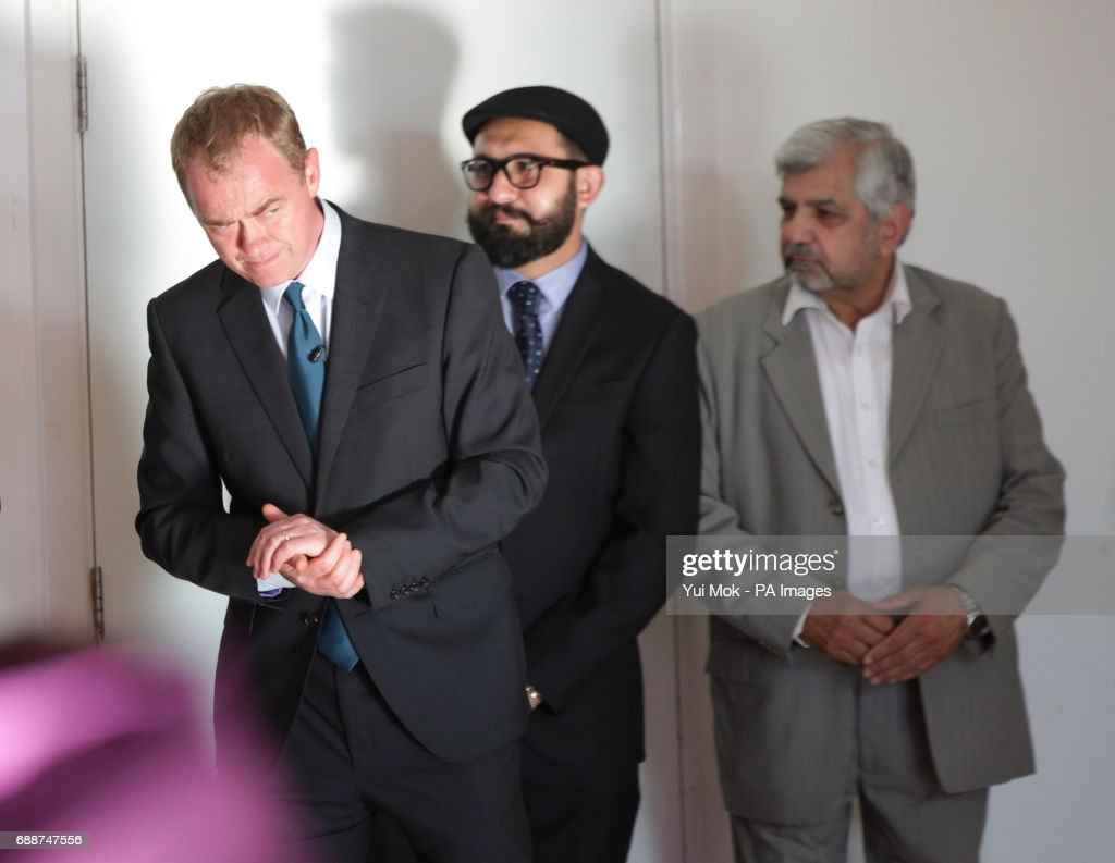 Liberal Democrat leader Tim Farron (left) attends a remembrance service with the Ahmadiyya Community, at the Darul Aman Mosque, as part of a General Election campaign event in Manchester.
