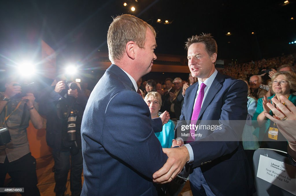 Liberal Democrat leader Tim Farron is congratulated by Nick Clegg as he leaves the main hall following his leader's speech on the final day of the Liberal Democrats annual conference on September 23, 2015 in Bournemouth, England. The Liberal Democrats are currently holding their annual conference using the hashtag #LibDemfightback in Bournemouth. The conference is the first since the party lost all but eight of its MPs in May's UK general election, however after gaining 20,000 new members since May the party is expecting a record attendance at the event being held at the Bournemouth International Centre.