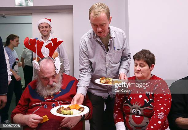 Liberal Democrat leader Tim Farron serves meals to Margaret Crossan and Stuart Bathgate during a visit to the Salvation Army homeless dropin centre...
