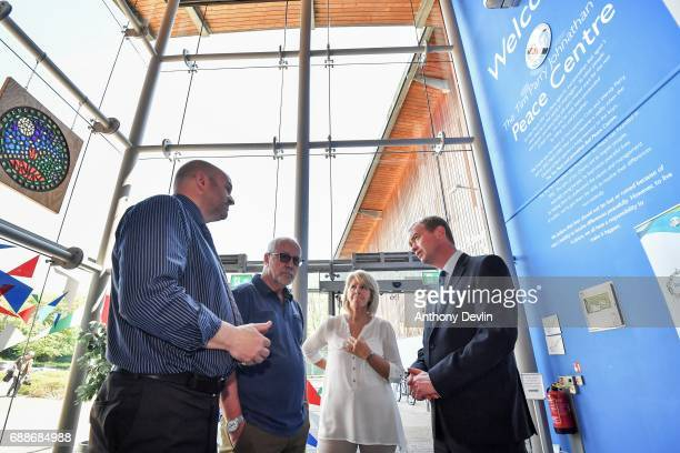Liberal Democrat leader Tim Farron speaks with chief executive Nick Taylor and Colin Parry and Wendy Parry the parents of Tim Parry during a visit to...