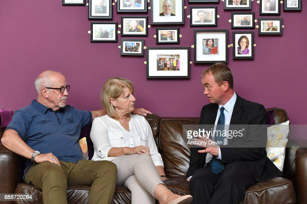 Liberal Democrat leader Tim Farron speaks with Colin Parry and Wendy Parry the parents of Tim Parry during a visit to the Tim Parry Jonathan Bell...
