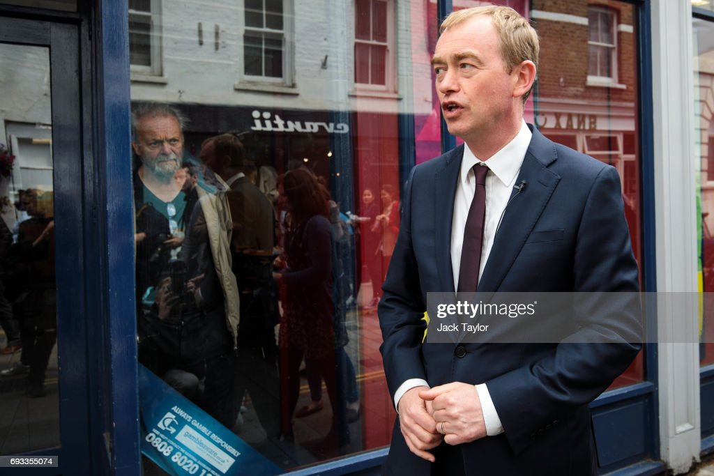 Liberal Democrat Leader Tim Farron walks past a betting shop as he campaigns with former Secretary of State for Business, Innovation and Skills Vince Cable (not pictured) in Twickenham on June 7, 2017 in Twickenham, England. Mr Cable is campaigning to retake his former seat after it was won by Conservative Tania Mathias in the 2015 general election. Britain goes to the polls tomorrow June 8 in a general election.
