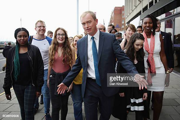 Liberal Democrat leader Tim Farron walks with party members from his hotel to the confrerence centre on the final day of the Liberal Democrat...