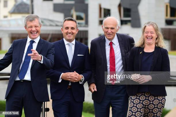 Liberal Democrat leader Vince Cable Scottish party leader Willie Rennie Alex ColeHamilton MSP and Councillor Hal Osler joke with photographers as...