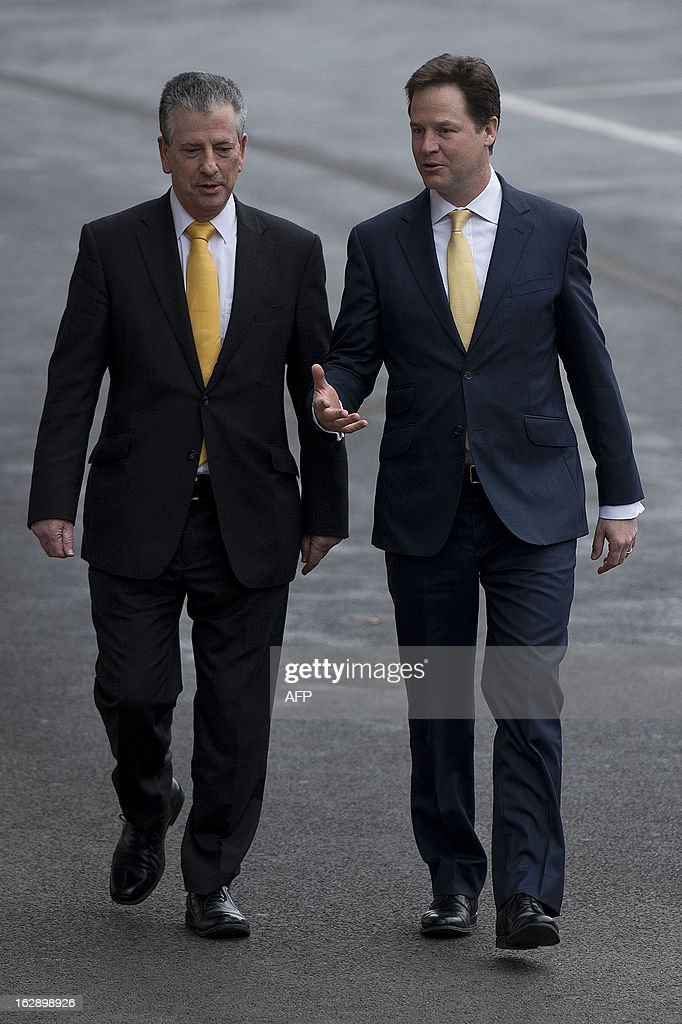 Liberal Democrat new member of parliament for Eastleigh Mike Thornton (L) and Liberal Democrat leader and Deputy Prime Minister Nick Clegg (R) walk together after their by-election win in Eastleigh, Hampshire, southern England on March 1, 2013. The Liberal Democrats on March 1 hung onto the southern England parliamentary seat of Eastleigh, dealing a heavy blow to Prime Minister David Cameron whose Conservative Party were beaten into third place.