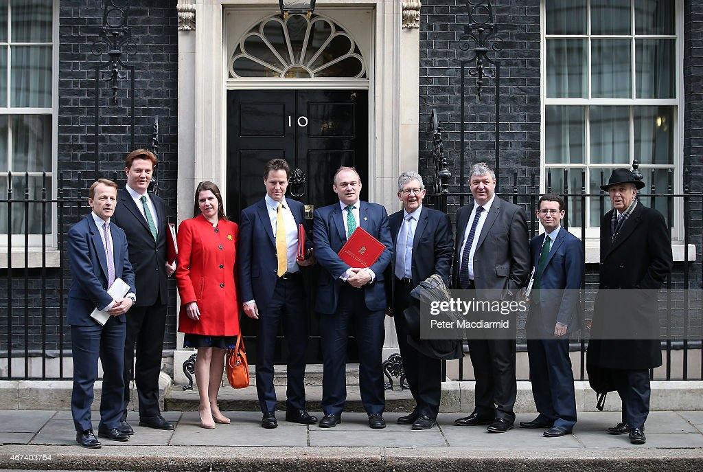 Liberal Democrat party cabinet members lead by party leader Nick Clegg stand in Downing Street before attending the last cabinet meeting during this...