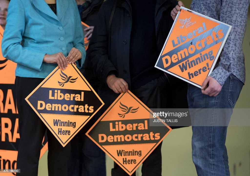 Liberal Democrat Party supporters wait with placards ahead of a campaign event in London on April 24, 2017, in the build-up to the general election on June 8th. Tim Farron, whose centre-left party holds just nine seats, hopes to make gains in the surprise election in June. / AFP PHOTO / Justin TALLIS