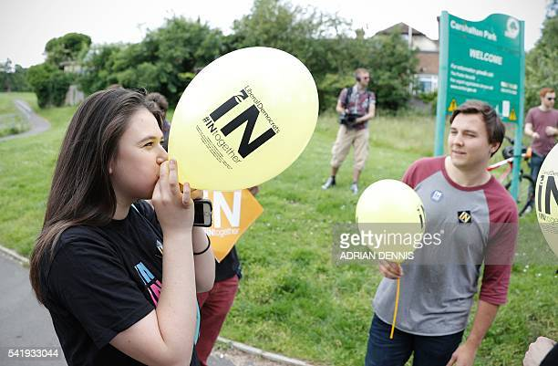 Liberal Democrat supporters blow up balloons ahead of a remain rally by Liberal Democrat Leader Tim Farron in Carshalton south of London on June 21...