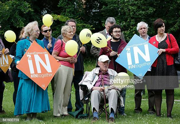 Liberal Democrat supporters gather in a park for a remain rally by Liberal Democrat Leader Tim Farron in Carshalton south of London on June 21 2016...