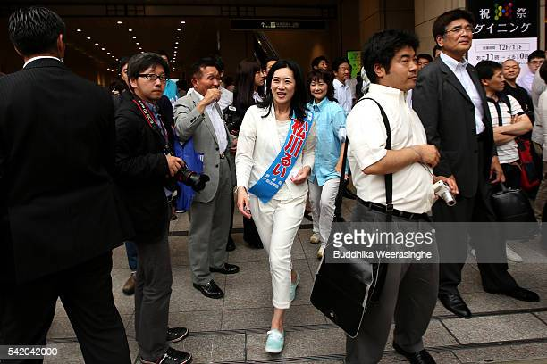 Liberal Democratic Party candidate Rui Matsukawa arrives to speak to voters during her election campaign for the upcoming upper house election on...