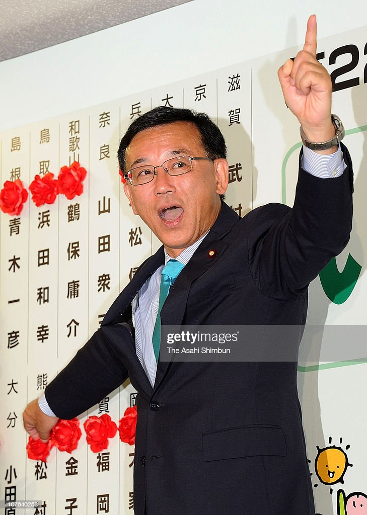 Liberal Democratic Party (LDP) leader <a gi-track='captionPersonalityLinkClicked' href=/galleries/search?phrase=Sadakazu+Tanigaki&family=editorial&specificpeople=570027 ng-click='$event.stopPropagation()'>Sadakazu Tanigaki</a> poses for photographs at their campaign headquarters on July 12, 2010 in Tokyo, Japan.