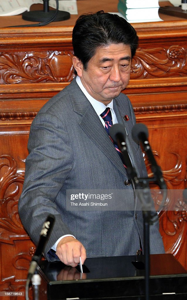 Liberal Democratic Party president <a gi-track='captionPersonalityLinkClicked' href=/galleries/search?phrase=Shinzo+Abe&family=editorial&specificpeople=559017 ng-click='$event.stopPropagation()'>Shinzo Abe</a> casts a vote at the lower house at the diet building on December 26, 2012 in Tokyo, Japan. Abe becomes Japan's 96th prime minister, seventh in six years.