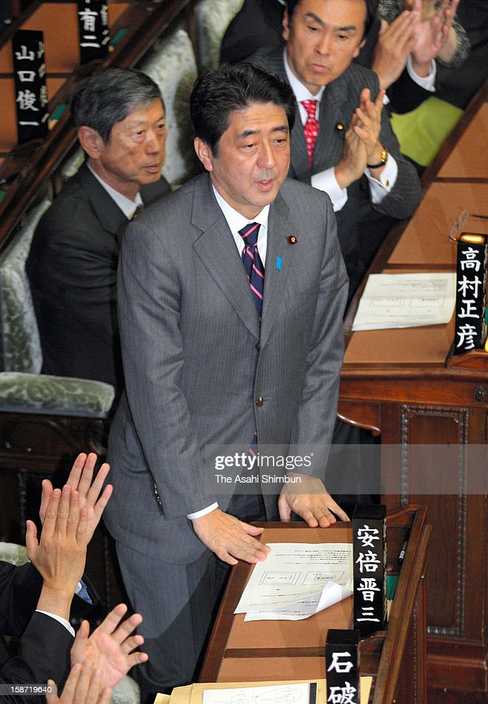 Liberal Democratic Party president <a gi-track='captionPersonalityLinkClicked' href=/galleries/search?phrase=Shinzo+Abe&family=editorial&specificpeople=559017 ng-click='$event.stopPropagation()'>Shinzo Abe</a> is applauded by fellow lawmakers after being elected at the lower house at the diet building on December 26, 2012 in Tokyo, Japan. Abe becomes Japan's 96th prime minister, seventh in six years.