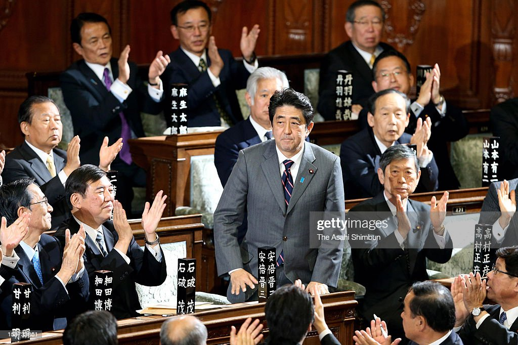 Liberal Democratic Party president <a gi-track='captionPersonalityLinkClicked' href=/galleries/search?phrase=Shinzo+Abe&family=editorial&specificpeople=559017 ng-click='$event.stopPropagation()'>Shinzo Abe</a> is applaunded by fellow lawmakers after being elected at the lower house at the diet building on December 26, 2012 in Tokyo, Japan. Abe becomes Japan's 96th prime minister, seventh in six years.