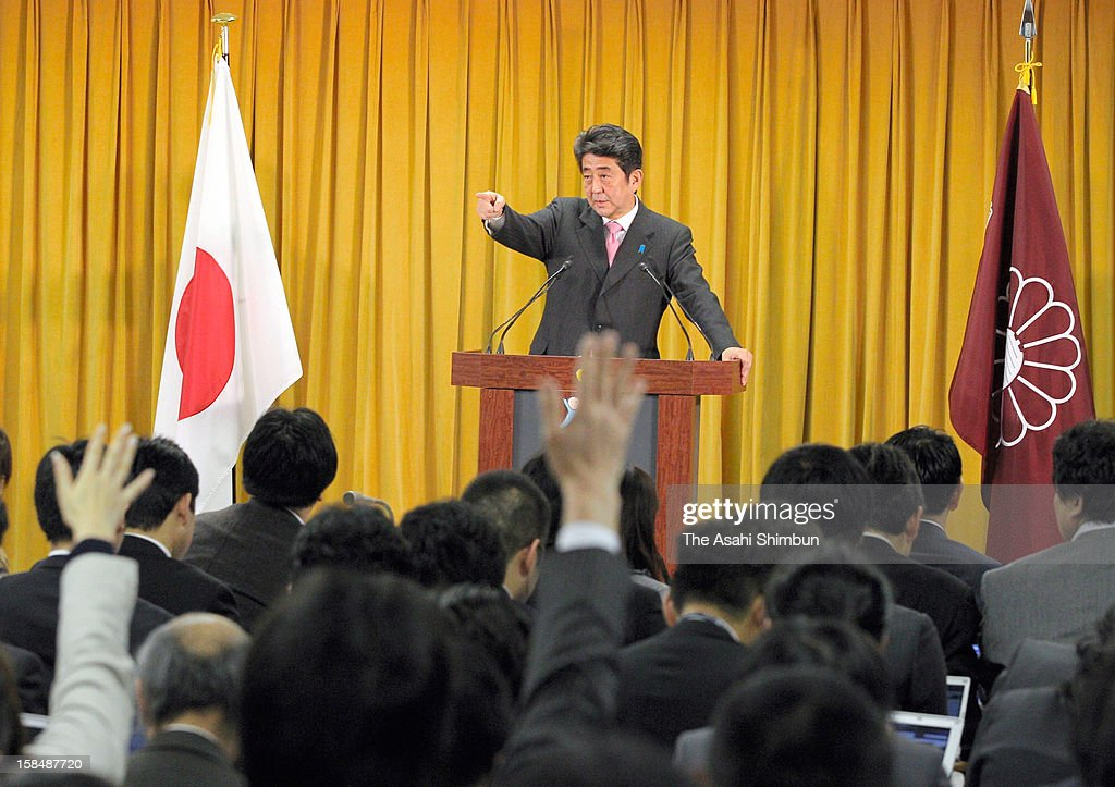 Liberal Democratic Party president <a gi-track='captionPersonalityLinkClicked' href=/galleries/search?phrase=Shinzo+Abe&family=editorial&specificpeople=559017 ng-click='$event.stopPropagation()'>Shinzo Abe</a> motions during a press conference a day after the LDP's ladnslide win in the general election at the LDP headquarters on December 17, 2012 in Tokyo, Japan.