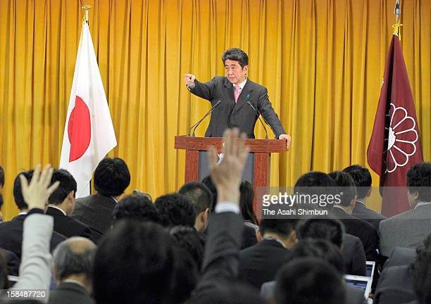 Liberal Democratic Party president Shinzo Abe motions during a press conference a day after the LDP's ladnslide win in the general election at the...