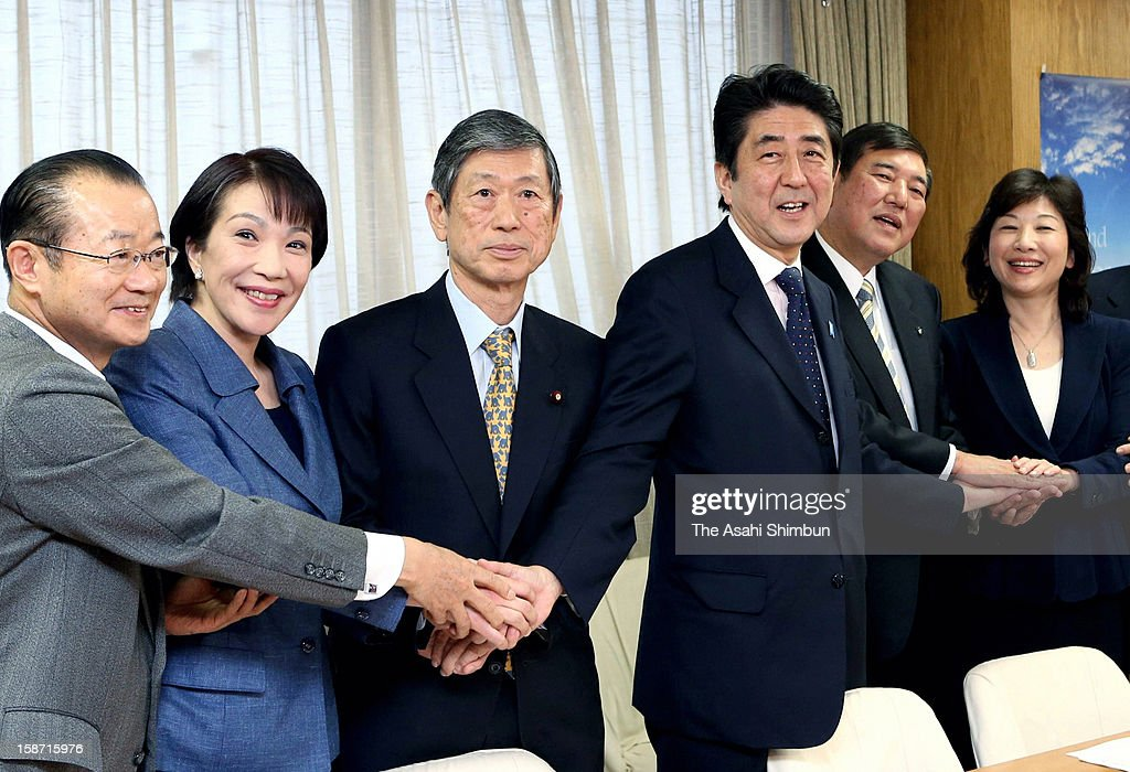 Liberal Democratic Party President Shinzo Abe (3R) shakes hands with election bureau chief Tateo Kawamura (1L), policy chief Sanae Takaichi (2L), vice president Masahiko Komura (3L), general secretary Shigeru Ishiba (2R) and general council chief Seiko Noda at the LDP headquarters on December 25, 2012 in Tokyo, Japan. Abe will be appointed as Japan's new prime minister on December 26.