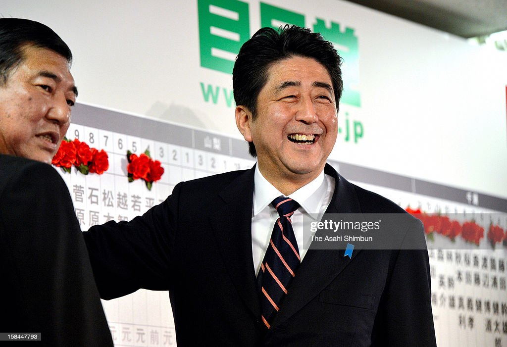 Liberal Democratic Party (LDP) president <a gi-track='captionPersonalityLinkClicked' href=/galleries/search?phrase=Shinzo+Abe&family=editorial&specificpeople=559017 ng-click='$event.stopPropagation()'>Shinzo Abe</a> smiles at their headquarters on December 16, 2012 in Tokyo, Japan. The LDP and coalition New Komeito gained 325 seats at the lower house and return to power while ruling DPJ made the historical defeat, dropped to 57 seat.