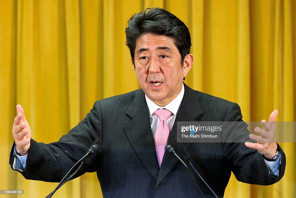Liberal Democratic Party president <a gi-track='captionPersonalityLinkClicked' href=/galleries/search?phrase=Shinzo+Abe&family=editorial&specificpeople=559017 ng-click='$event.stopPropagation()'>Shinzo Abe</a> speaks during a press conference a day after the LDP's ladnslide win in the general election at the LDP headquarters on December 17, 2012 in Tokyo, Japan.