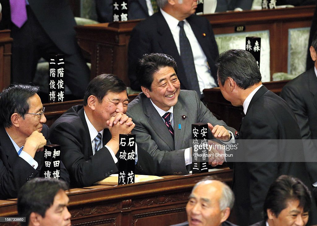 Liberal Democratic Party president <a gi-track='captionPersonalityLinkClicked' href=/galleries/search?phrase=Shinzo+Abe&family=editorial&specificpeople=559017 ng-click='$event.stopPropagation()'>Shinzo Abe</a> speaks with a fellow lawmakers at the lower house at the diet building on December 26, 2012 in Tokyo, Japan. Abe becomes Japan's 96th prime minister, seventh in six years.