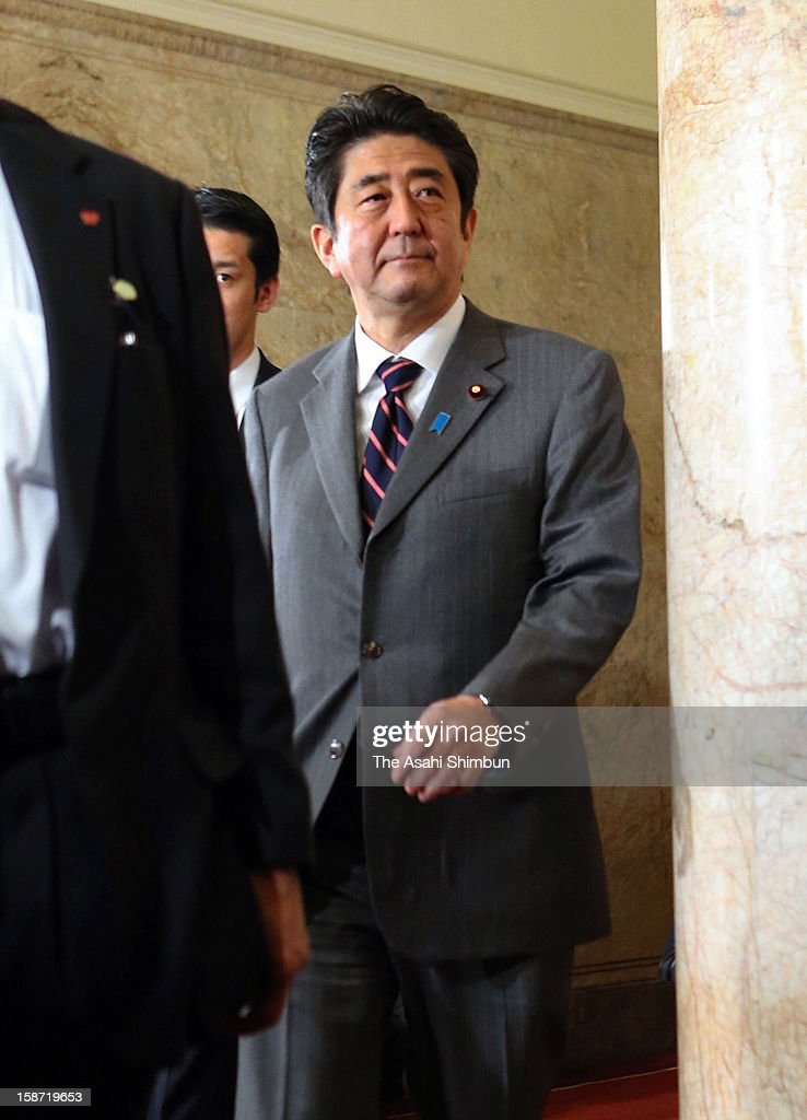 Liberal Democratic Party president <a gi-track='captionPersonalityLinkClicked' href=/galleries/search?phrase=Shinzo+Abe&family=editorial&specificpeople=559017 ng-click='$event.stopPropagation()'>Shinzo Abe</a> walks the corridor to the lower house at the diet building on December 26, 2012 in Tokyo, Japan. Abe becomes Japan's 96th prime minister, seventh in six years.
