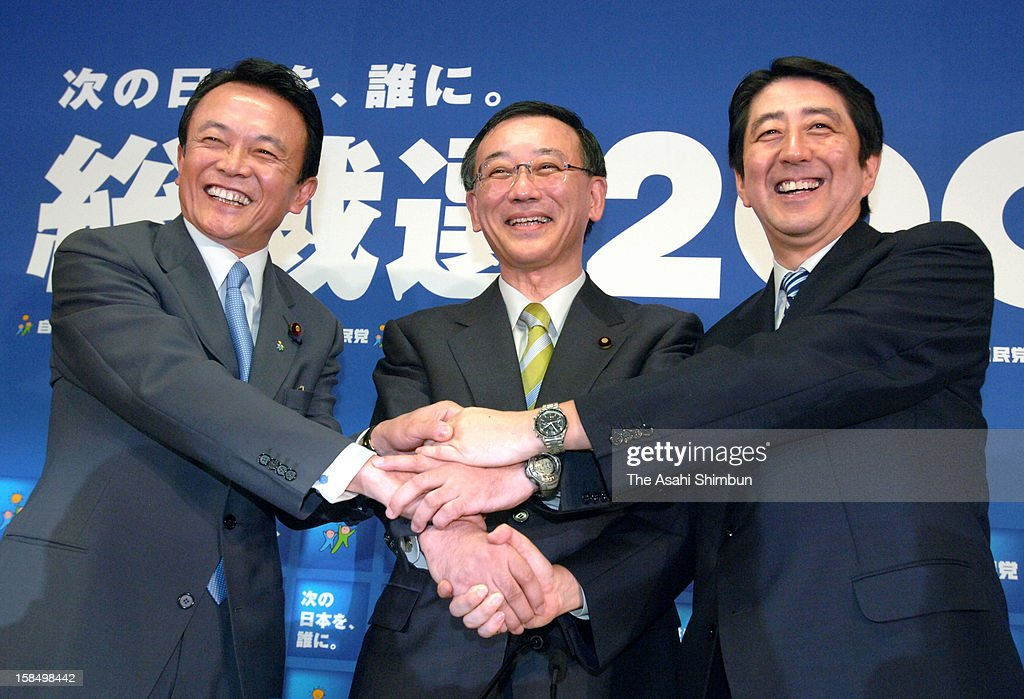 Liberal Democratic Party presidential election candidates <a gi-track='captionPersonalityLinkClicked' href=/galleries/search?phrase=Taro+Aso&family=editorial&specificpeople=559212 ng-click='$event.stopPropagation()'>Taro Aso</a>, <a gi-track='captionPersonalityLinkClicked' href=/galleries/search?phrase=Sadakazu+Tanigaki&family=editorial&specificpeople=570027 ng-click='$event.stopPropagation()'>Sadakazu Tanigaki</a> and <a gi-track='captionPersonalityLinkClicked' href=/galleries/search?phrase=Shinzo+Abe&family=editorial&specificpeople=559017 ng-click='$event.stopPropagation()'>Shinzo Abe</a> shake hands during a joint press conference at the LDP headquarters on September 8, 2006 in Tokyo, Japan.