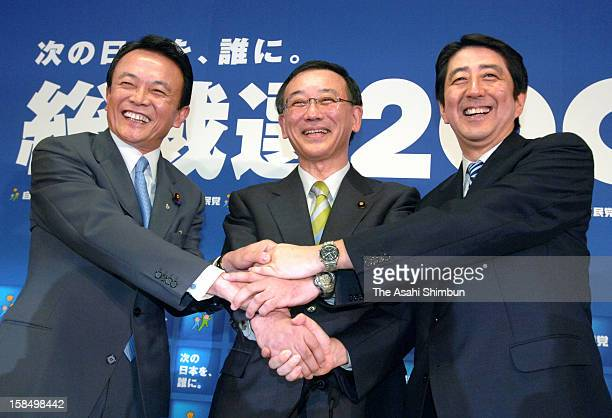 Liberal Democratic Party presidential election candidates Taro Aso Sadakazu Tanigaki and Shinzo Abe shake hands during a joint press conference at...