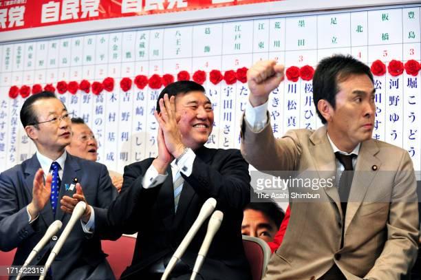 Liberal Democratic Party Secretary General Shigeru Ishiba and Environment Minister Nobuteru Ishihara celebrate their landslide victory at Tokyo...