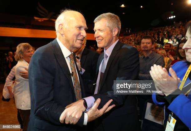 Liberal Democrats leader Sir Vince Cable is congratulated by Leader of the Scottish Liberal Democrats Willie Rennie after making his keynote speech...