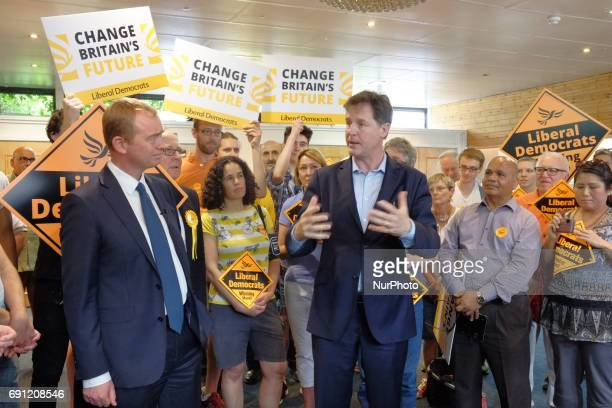 Liberal Democrats leader Tim Farron looks on as Nick Clegg MP speaks during a rally at the Shiraz Mirza Community Hall on June 1 2017 in Kingston...