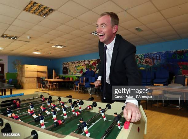 Liberal Democrats leader Tim Farron plays a game on table football during a visit to charity Gloustershire Action for Refugess and Asylum Seekers in...