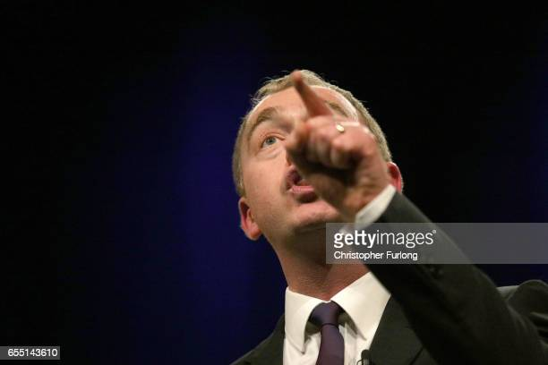 Liberal Democrats party leader Tim Farron delivers his keynote speech to party members on the last day of the Liberal Democrats spring conference at...