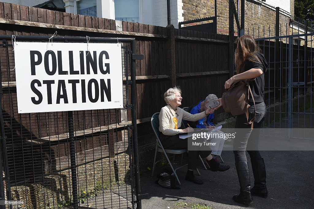A Liberal Democray Party's voluntary telling agent helps a local woman as she arrives at the St Agnes Centre in Barnet, North London to register her vote in the Mayoral and Assembly elections on May 5, 2016 in Barnet, United Kingdom. Due to registration issues there have been problems for voters throughout the day. Today,dubbed 'Super Thursday',sees the British public vote in countrywide elections to choose members for the Scottish Parliament, the Welsh Assembly, the Northern Ireland Assembly, Local Councils, a new London Mayor and Police and Crime Commissioners. There are around 45 million registered voters in the UK and polling stations open from 7am until 10pm.