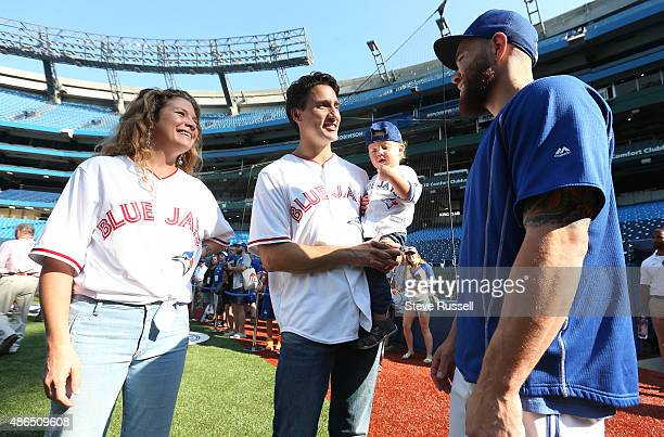 TORONTO ON SEPTEMBER 4 Liberal Leader Justin Trudeau holding his son Hadrien and with his wife Sophie talk with Toronto Blue Jays catcher Russell...