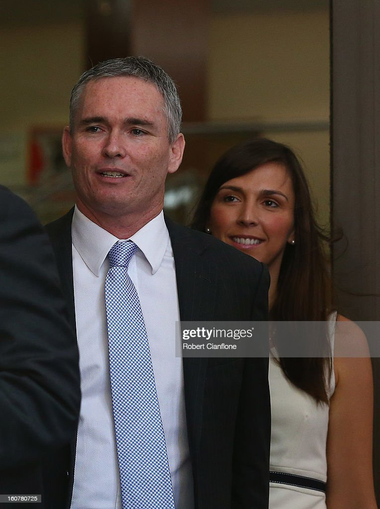 Liberal MP, Craig Thomson and his wife Zoe Arnold leave Melbourne Magistrates Court on February 6, 2013 in Melbourne, Australia. Thompson is facing charges on 149 criminal charges including allegations he misused member funds to pay prostitutes, book travel and withdraw cash when he was national secretary of the Heatlh Services Union.