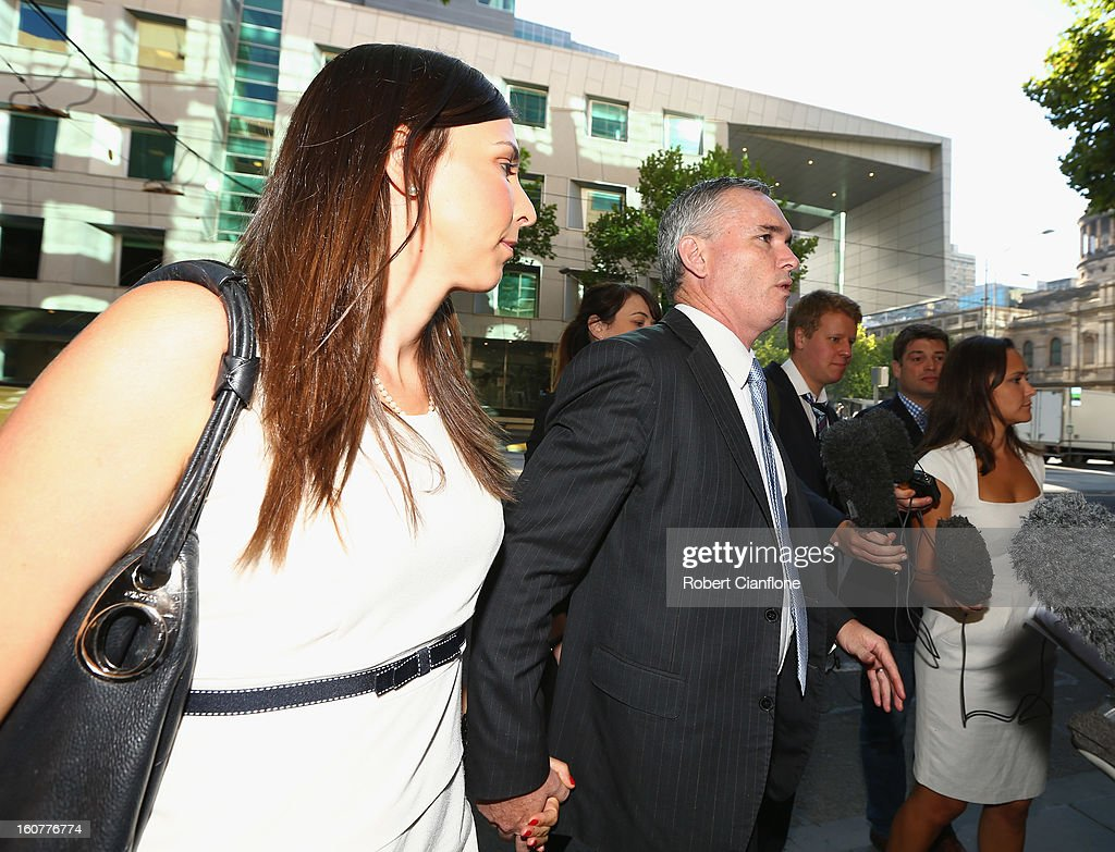 Liberal MP, Craig Thomson arrives with his wife Zoe Arnold at Melbourne Magistrates Court on February 6, 2013 in Melbourne, Australia. Thompson is facing charges on 149 criminal charges including allegations he misused member funds to pay prostitutes, book travel and withdraw cash when he was national secretary of the Heatlh Services Union.