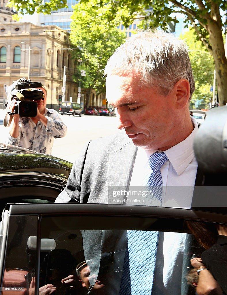 Liberal MP, Craig Thomson leaves the Melbourne Magistrates Court on February 6, 2013 in Melbourne, Australia. Thompson is facing charges on 149 criminal charges including allegations he misused member funds to pay prostitutes, book travel and withdraw cash when he was national secretary of the Heatlh Services Union.