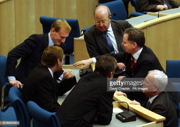 Liberal MSP Tavish Scott Ross Finnie Scottish Labour leader Jack McConnell and Liberal MSP s Nicol Stephen George Lyon and Jim Wallace during a break...