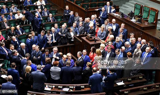 Liberal opposition lawmakers gather around podium before speaker of Parliament Marek Kuchcinski formally opened a new session of Poland's parliament...