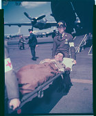 Liberated American Evacuated to Japan An unidentified American is removed from a C124 transport plane at Tachikawa Air Force Bae Japan following his...