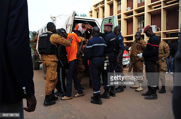 Liberated hostages are escorted by special forces following an attack by AlQaeda linked gunmen on January 16 2016 in Ouagadougou Security forces in...