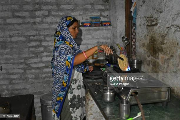 ALWAR RAJASTHAN ALWAR RAJASTHAN INDIA Liberated manual scavenger Laxmi Nanda cooks meal for her family inside her kitchen in her house Before her...